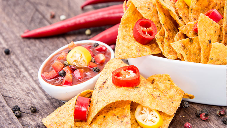 A tortilla chip is a snack food made from corn tortillas that are cut into wedges and then fried. Corn tortillas are made of corn, vegetable oil, salt and water. Although tortilla chips are considered to be a Mexican food, they are popular with most people who have ever tasted...