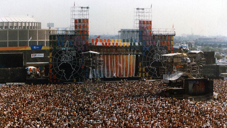 On July 13, 1985, at Wembley Stadium in London, Prince Charles and Princess Diana officially open Live Aid, a worldwide rock concert organized to raise money for the relief of famine-stricken Africans. Live Aid was the first internationally minded charity concert.   Live Aid was the...